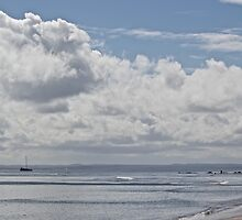 Clouds, sea, sky and sihouettes by Greta van der Rol