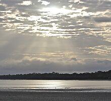 Sunlight slicing through cloud by Greta van der Rol