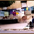 Kids and Clothesline in Senegal by Wayne King