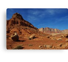 Boulders, red rocks and mountains Canvas Print