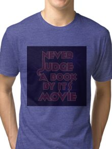Never Judge A Book By Its Movie (Purple on Blue) Tri-blend T-Shirt