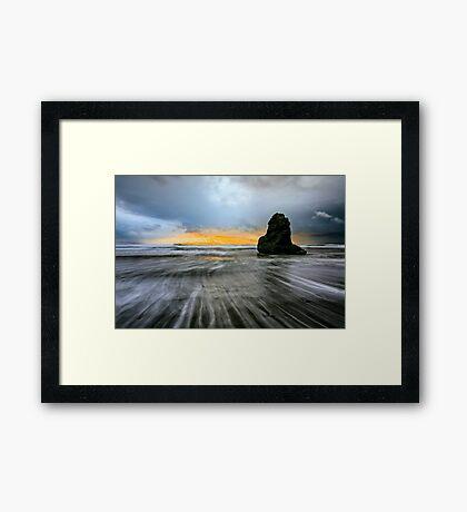 Stormy beach sunset Framed Print