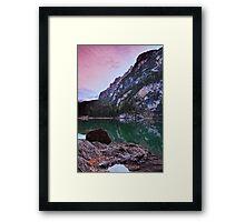 Reddish morning sky over lake Framed Print