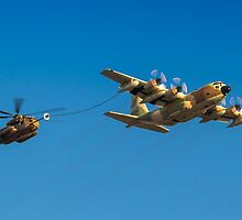 Hercules C-130 transport plane refuelling by PhotoStock-Isra