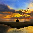 Lonely Boat on Beach by arthit somsakul