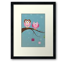 Two cute owls on the tree branch Framed Print