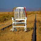 Lone Chair Waiting on never coming train by Jessie Miller/Lehto