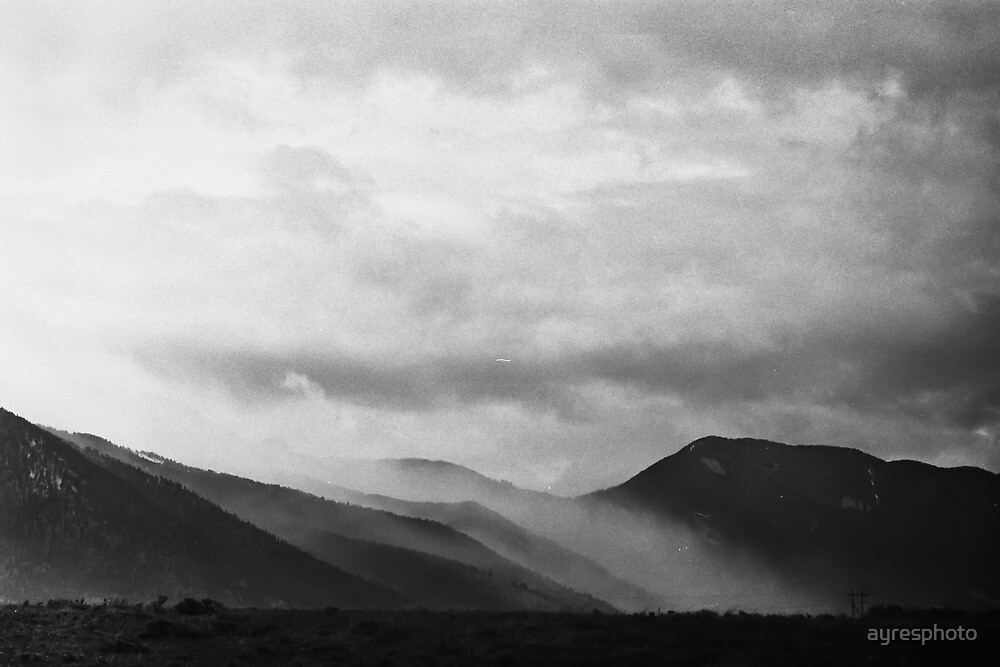 Mist Rolling over the Mountains in Yellowstone by ayresphoto
