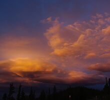 Colourful evening clouds, Rocky Mountains, Colorado by Claudio Del Luongo