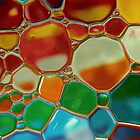 oil bubbles on water by Graham McAndrew
