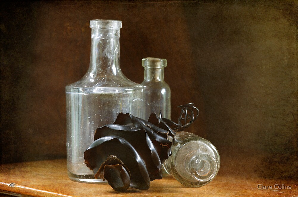 3 glass bottles and a shark egg by Clare Colins