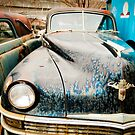 Old Chrysler Sedan in a Junk Yard by Sam Scholes