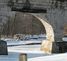 Arch over Icy Water by Liesl Gaesser