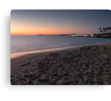 Sunset on a beach shore  Canvas Print