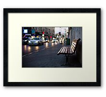 empty bench and busy road Framed Print