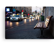 empty bench and busy road Canvas Print