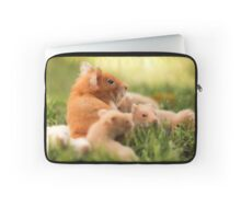 Golden hamster with her young litter on the lawn Laptop Sleeve
