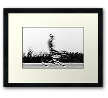 Motion blur of a bicycle rider in black and white  Framed Print