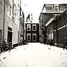 Amsterdam alley covered with snow by pahas