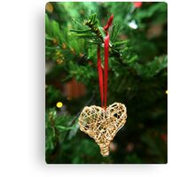 Golden heart ornament hanging Canvas Print