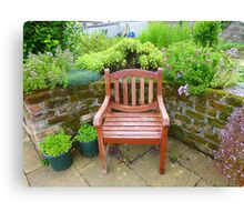 A Seat In The Herb Garden Canvas Print