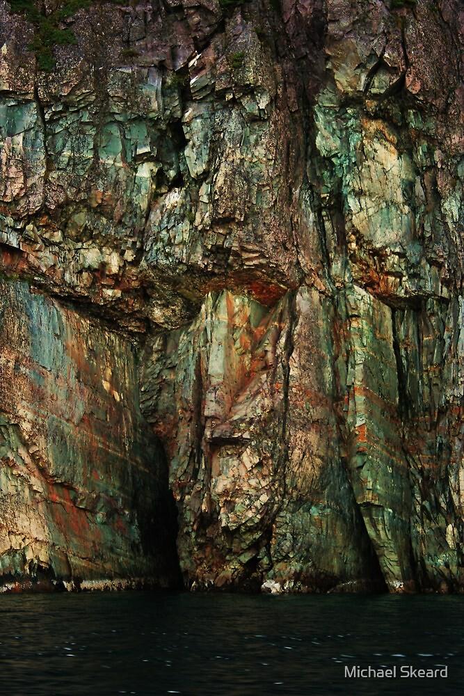 Man's Face in cliff side  by Michael Skeard