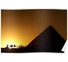 Four camel riders silhouetted at sunset near a pyramid in Egypt Poster