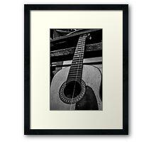 One stringed Passion Framed Print