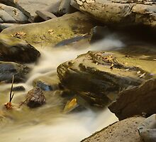 Rocks in waterfall by BrianFitePhoto
