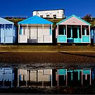 Beach huts reflected. by Karen  Betts