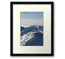 Skiing on the Ledge Framed Print
