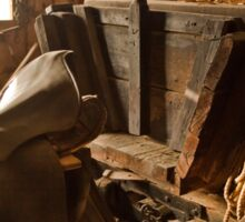 Old style agricultural tools in a wooden shed. Sticker