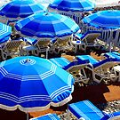 Blue Beach Umbrellas On The French Riviera by Fara