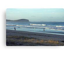 Evening walk on a beach Canvas Print