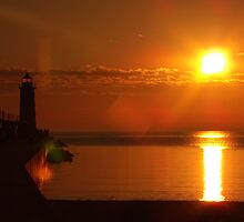 Sunset With lighthouse 1 by agrusag