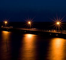 Wool Bay jetty at night from the cliff top by paul erwin