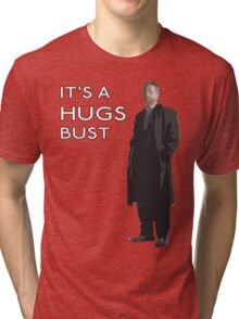 It's a hugs bust Tri-blend T-Shirt