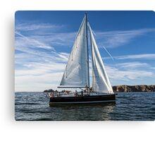 A sail boat off Alderney  Canvas Print