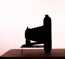 Vintage camera silhouette. by Benjamin Shepherd