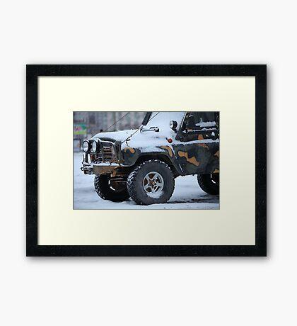 SUV in snow Framed Print