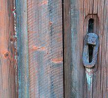 Old barn wall and lock by Kristian Tuhkanen