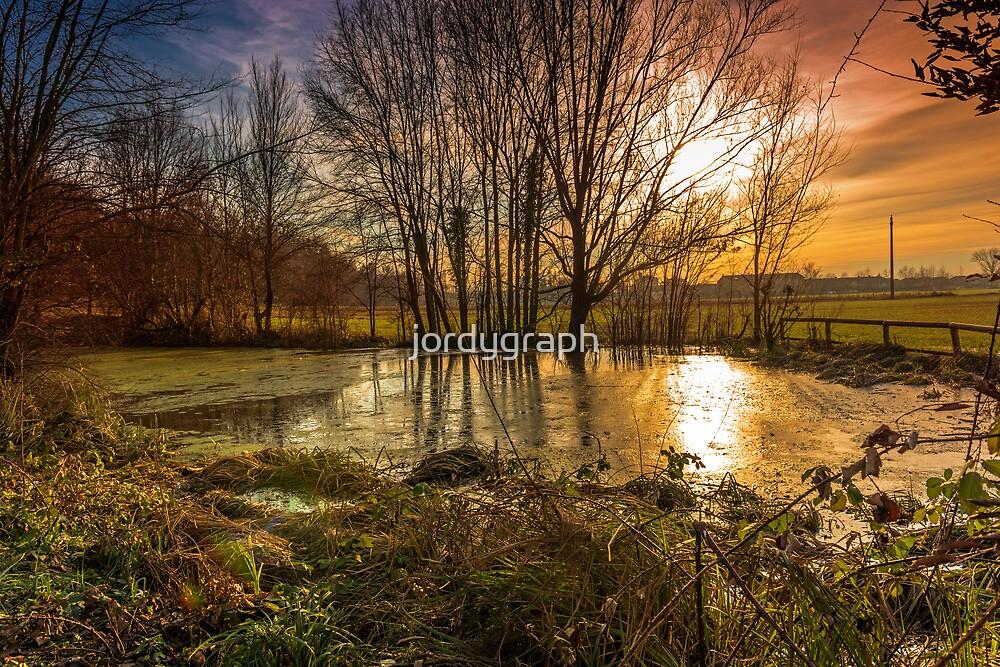 Sunset on pond by jordygraph