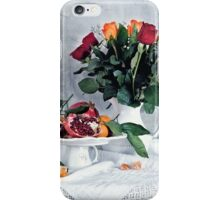 Still life with red pomegranate, orange tangerines and roses iPhone Case/Skin