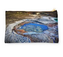 Water pools in sink holes on the shore of the Dead Sea Studio Pouch