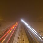Dual carriageway at night in the snow by simon17