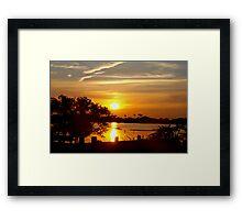 Seawall in silhouette Framed Print