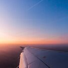 Sunrise from a plane vertical by LaurentS