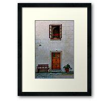 Door, Bench, And Window Framed Print