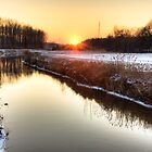 Sunset over the water by LaurentS