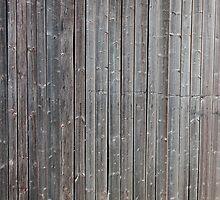 Old worn down barn wall by Kristian Tuhkanen